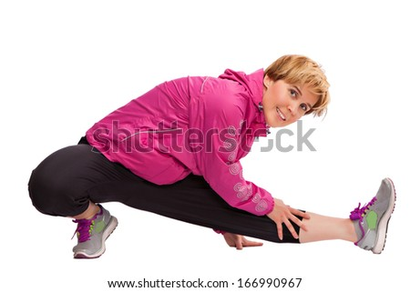 beautiful fitness woman doing stretching exercise, isolated - stock photo