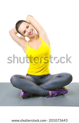 beautiful fitness woman smiling and stretching her hands, doing exercises on yoga mat, isolated on white background. Caucasian female fitness model - stock photo