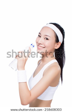 beautiful fitness woman with bottle of water and towel. sport. white background. - stock photo