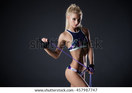beautiful fitness woman with the jump rope - stock photo