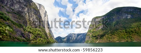 beautiful fjord in norway with panorama view of mountains, woods and ocean - stock photo