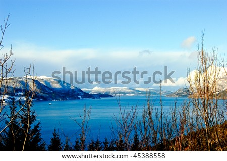 beautiful fjord landscape in Norway on sunny day, winter - stock photo