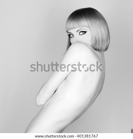 Beautiful flexible redhead girl with a bob haircut - stock photo