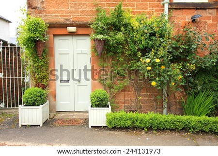 Beautiful floral decoration outside of the house - stock photo