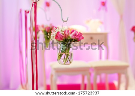 Beautiful flower arrangement in white and pink for wedding ceremony - stock photo