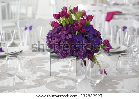 Beautiful flower bouquet decoration on wedding table - stock photo