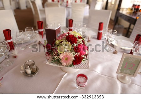 Beautiful flower decoration on wedding table - stock photo