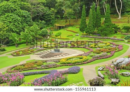 Beautiful flower garden on a hillside. - stock photo