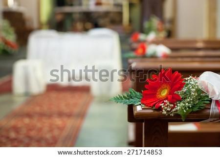 Beautiful flower wedding decoration in a church - stock photo