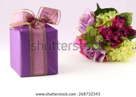 Beautiful flowers and elegant gift box in horizontal format - stock photo