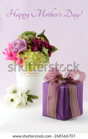 Beautiful flowers and elegant gift for a Mother's Day card in vertical format - stock photo