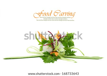 Beautiful flowers carved from fruits and vegetables isolated - stock photo