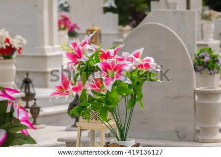 Beautiful flowers on a grave after a funeral. - stock photo