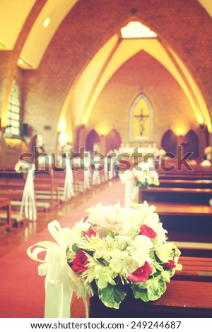 Beautiful flowers wedding decoration in church, process in vintage style. - stock photo