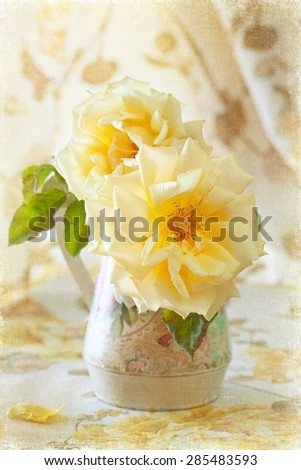 beautiful flowers. yellow roses in a vase on the table. vintage style ,grunge paper background.  - stock photo