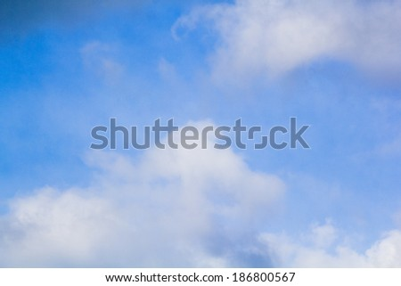 Beautiful, fluffy, white and grey clouds and blue sky  - stock photo
