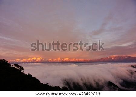beautiful fog among frozen mountain summits landscape - stock photo