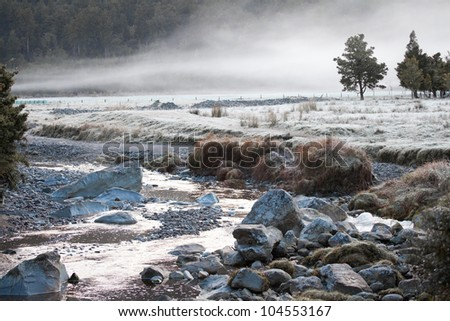 Beautiful fog in morning time and matheson river in autumn season Fox Glacier town New Zealand - stock photo