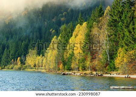 Beautiful foggy autumn landscape,Saint Anna Lake,Transylvania,Romania,Europe - stock photo