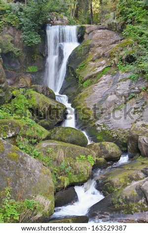 Beautiful forest waterfall. The highest waterfall in Germany. - stock photo