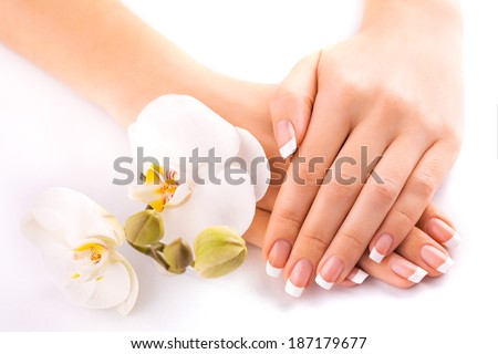 beautiful french manicure  on white - stock photo