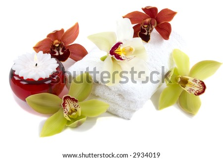 Beautiful fresh orchids, towel and candle - stock photo