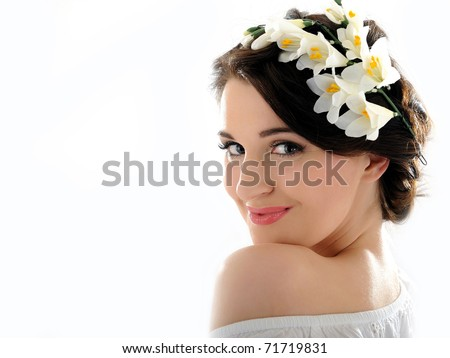 Beautiful fresh spring woman with flowers in her hair and pure skin - stock photo