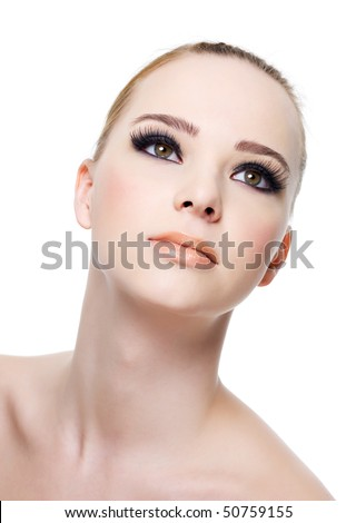 Beautiful fresh woman's face with black eye make-up - isolated on white - stock photo