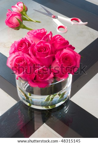 Beautiful freshly cut roses on a table - stock photo