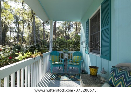 Beautiful front porch looking out onto forest - stock photo