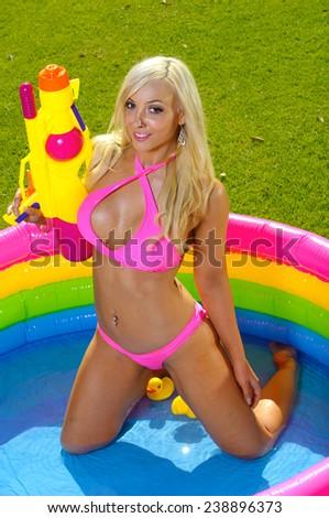 Beautiful fun bikini girl  - stock photo