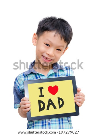 Beautiful funny Asian boy  holding a tablet computer with love Dad message on screen - stock photo