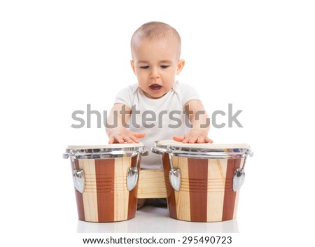 Beautiful funny baby child playing drums and singing isolated - stock photo