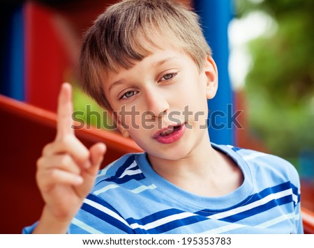 Beautiful funny child playing on playground in summer having an idea  - stock photo