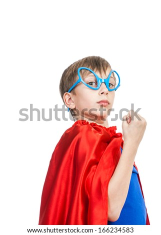 Beautiful funny child pretending to be superhero standing, looking strong and showing his fist   (superhero concept) - stock photo