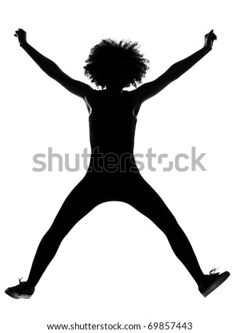 beautiful funny young afro american woman happy jumping in silhouette shadow on studio isolated white backgroung - stock photo