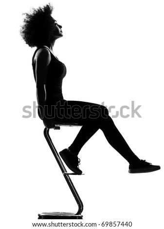 beautiful funny young afro american woman sitting on footstool pensive in silhouette shadow on studio isolated white background - stock photo