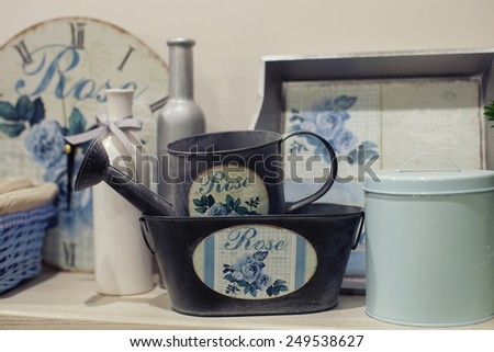 Beautiful furniture with tableware and decor,kitchen with vintage boxes - stock photo