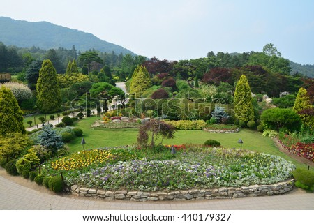 Beautiful garden of colorful flowers on hill - stock photo