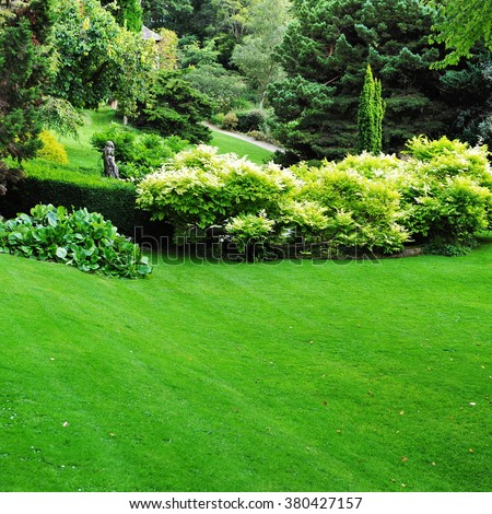 Beautiful Garden with a Freshly Mown Lawn - stock photo