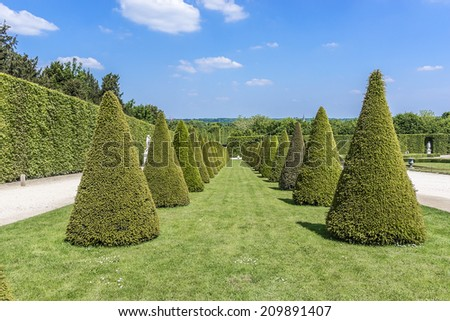 Beautiful Gardens of famous Versailles palace. The Palace of Versailles was a royal chateau. It was added to the UNESCO list of World Heritage Sites. Paris, France - stock photo