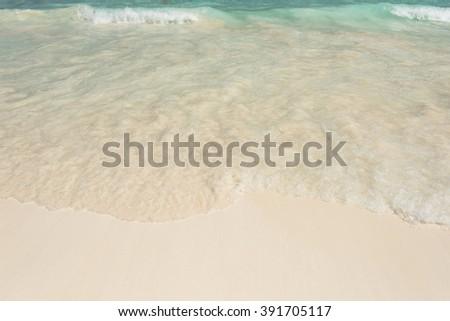 Beautiful Gentle wave  on white sandy  - stock photo