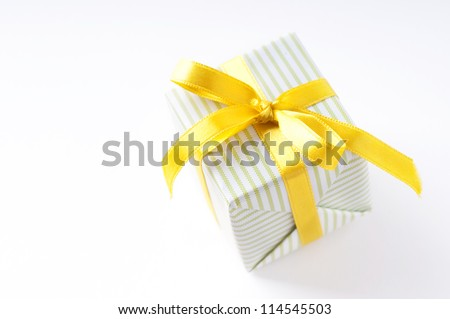beautiful gift box with yellow ribbon over white background isolated - stock photo