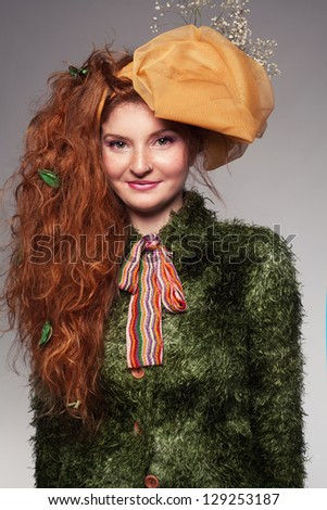 beautiful ginger woman in colorful clothes smiling and looking at camera - stock photo