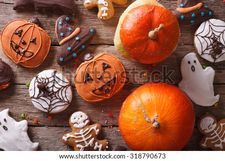 Beautiful gingerbread for Halloween and fresh pumpkin close-up on the table. horizontal view from above