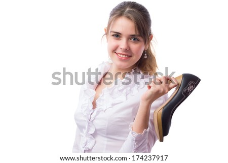 beautiful girl advertises high-heeled shoes in her hands - stock photo