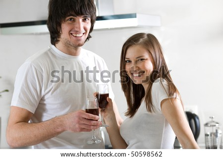 Beautiful girl and boy with wineglasses - stock photo