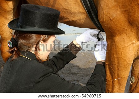 Beautiful girl and dressage horse after competitions - stock photo