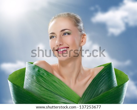 beautiful girl and green leaves - stock photo
