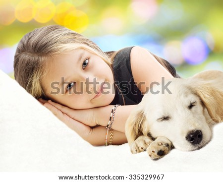 beautiful girl  and Puppy lying on the sofa - stock photo